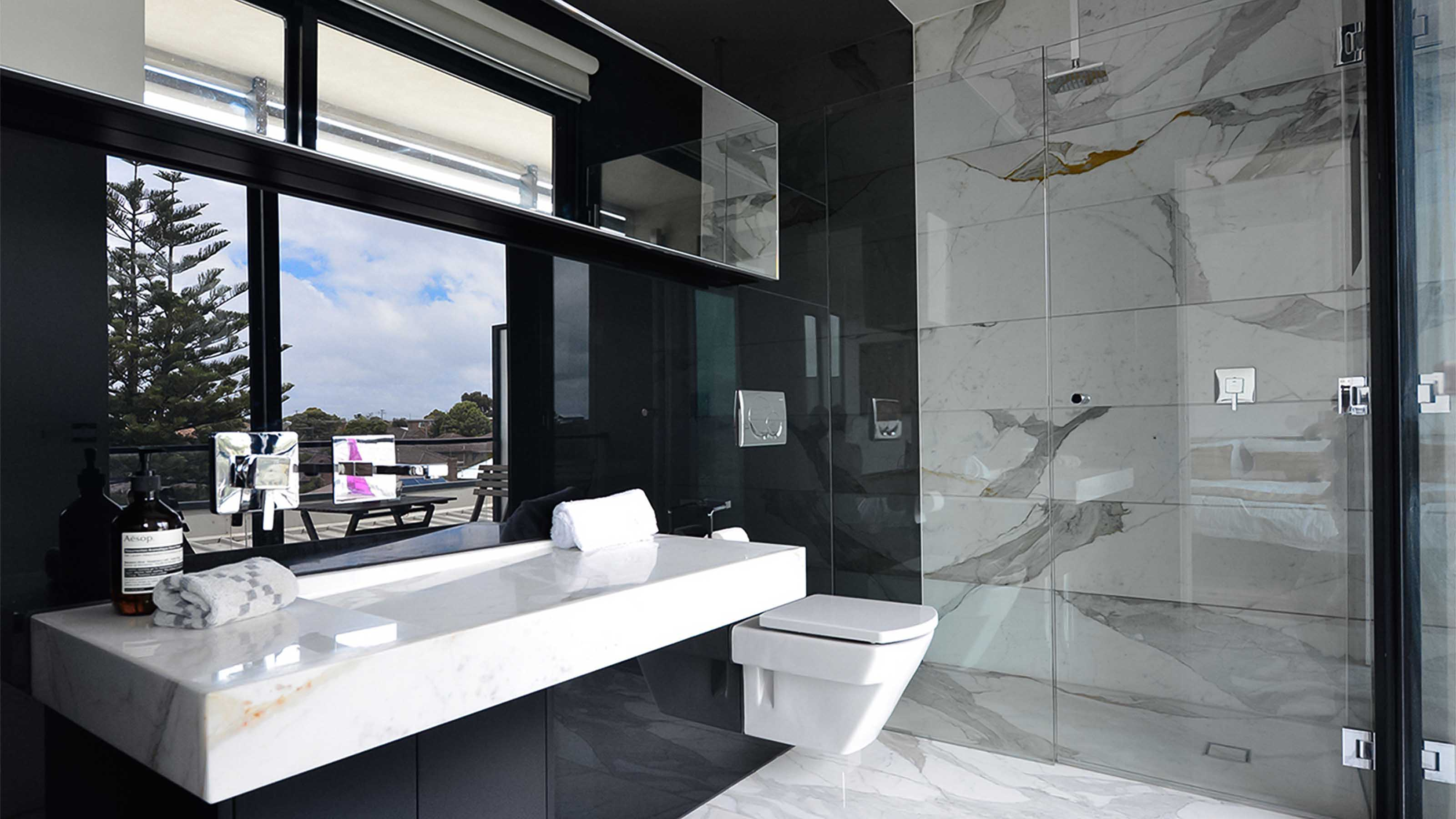 KOLOR™ & ATMOS™ & reFLECT™ - Black Glass Splashbacks - Frameless Shower Screen - Hydraulic Cabinet Mirror -  Wall Hung Toilet - Melbourne - Supplied & Installed by - geelongsplashbacks.com.au