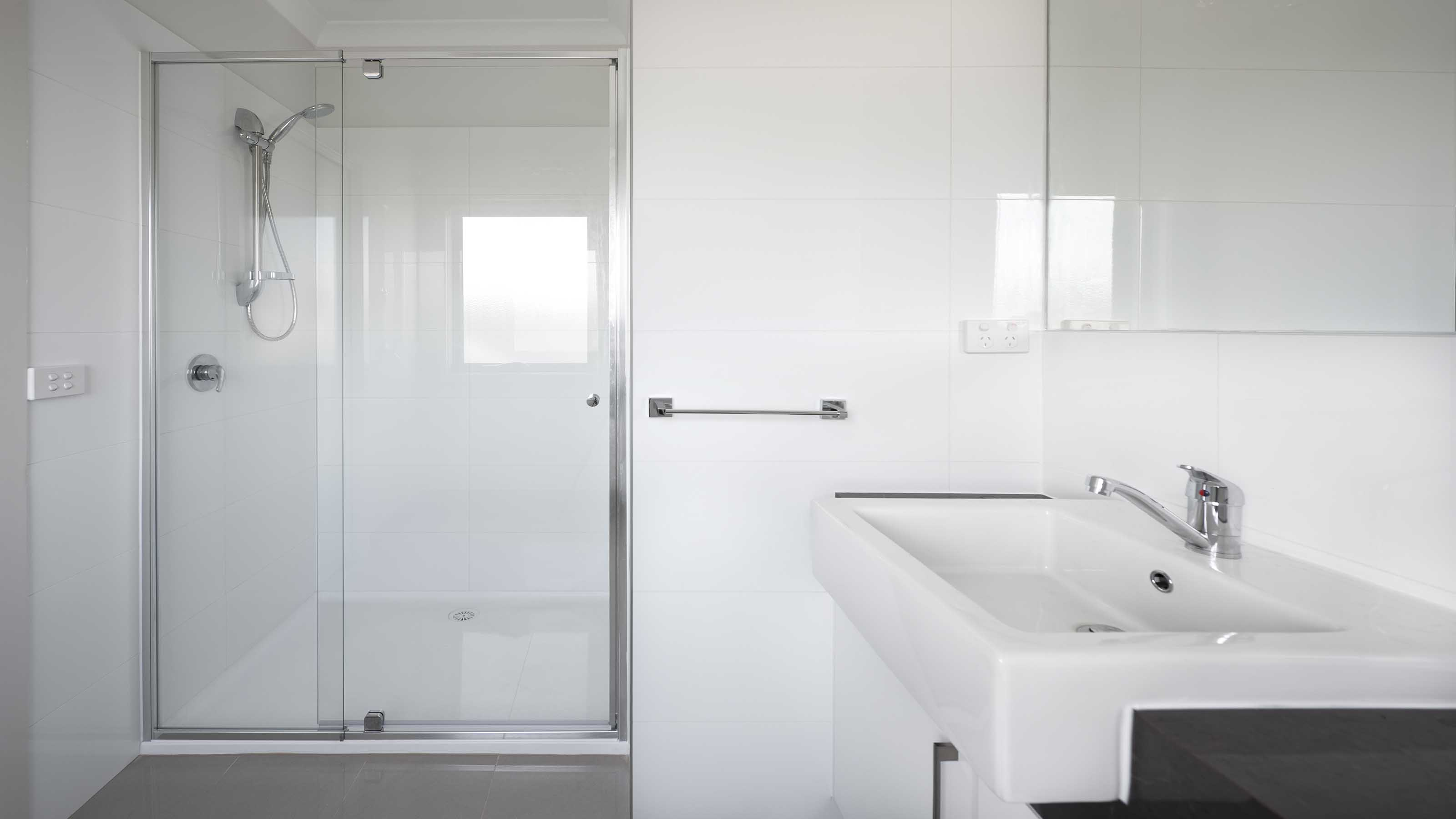 STREAM™ - Front Only 1/4 Frameless Shower Screen - Door Closed - Armstrong Creek - Supplied & Installed by - geelongsplashbacks.com.au